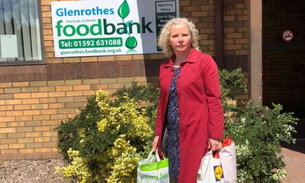 Claire Baker MSP helping Glenrothes Foodbank tackle holiday hunger for Fife schoolchildren.