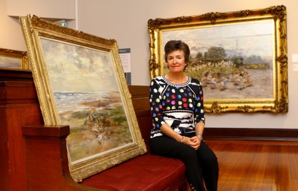 Claire Hunter Chow with her donated painting