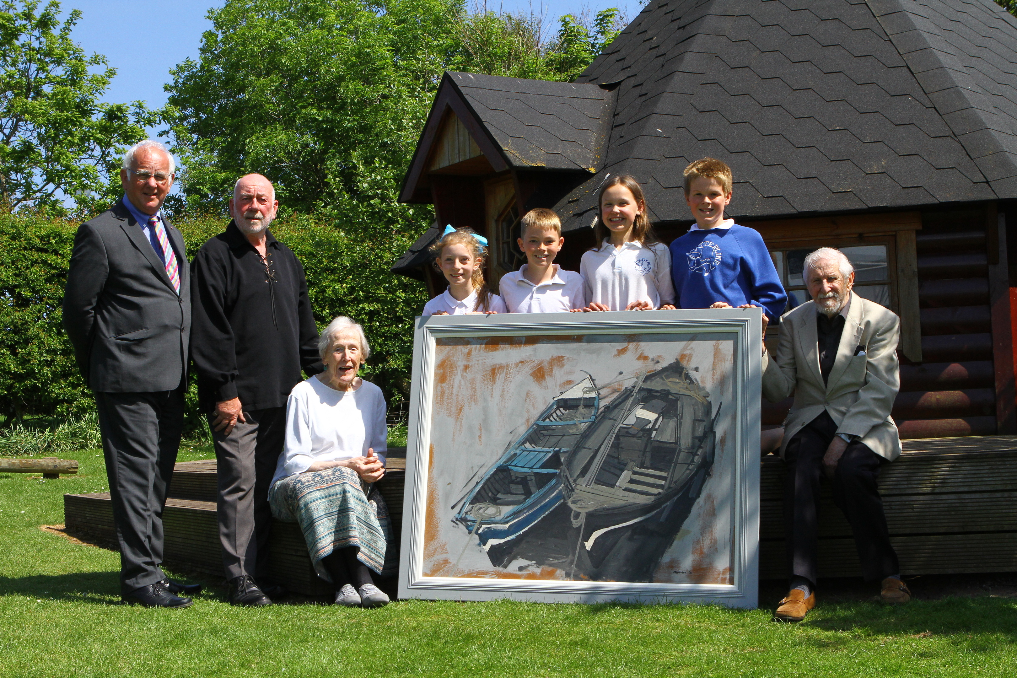 At an event earlier this year, Angus artist James Morrison R.S.A, R.S.W, with his painting Catterline Boats with (from left), Gordon Ritchie,  Dave Ramsay, Ann Keddie and pupils Lily Buchanan, Cameron Ramsay, Hannah Boggon and Magnus Gowland.
