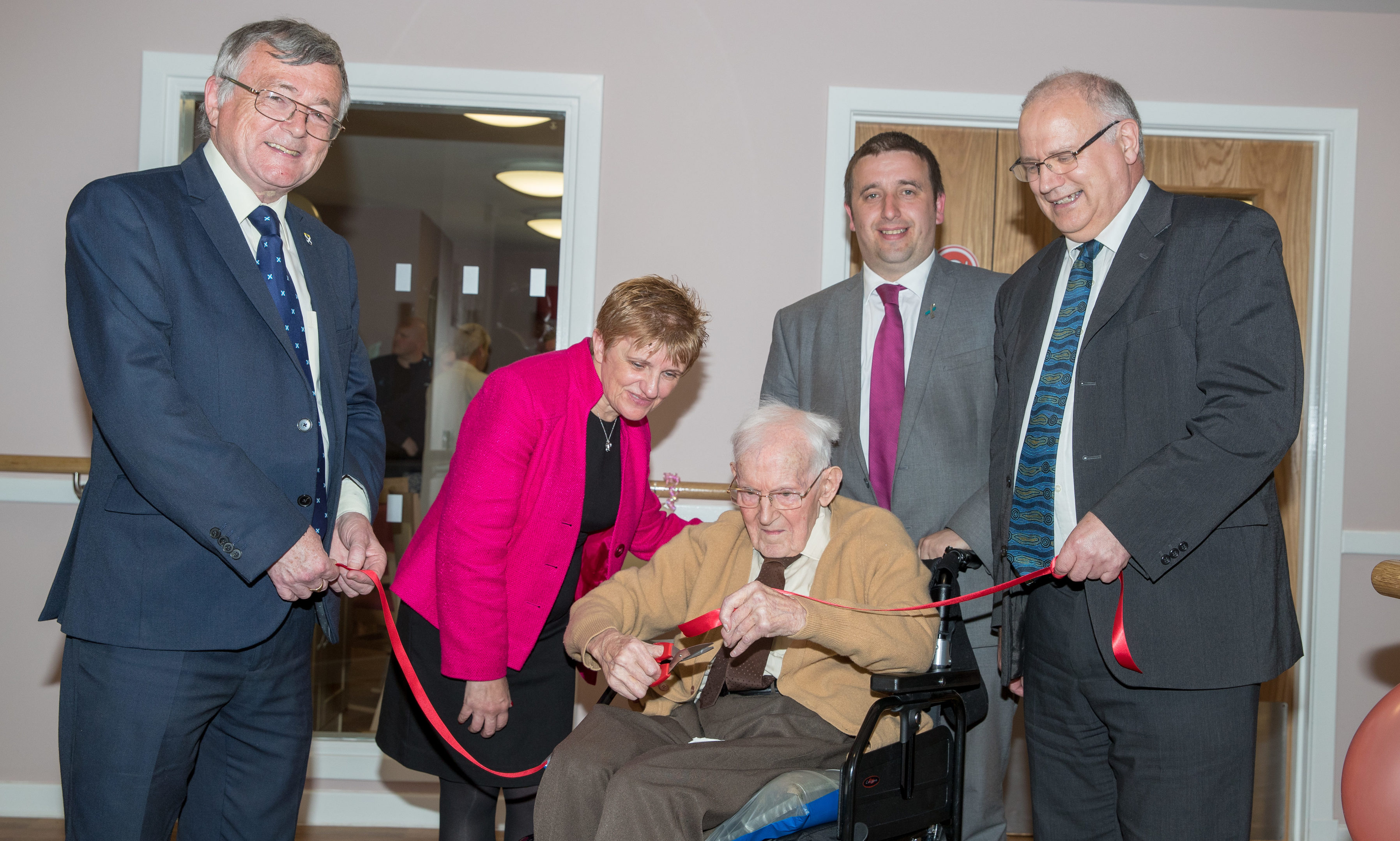Councilors David Alexander, Judy Hamilton, David Graham and David Ross help Lindsay Houses oldest resident, 99-year-old James Oliver, with the opening ceremony