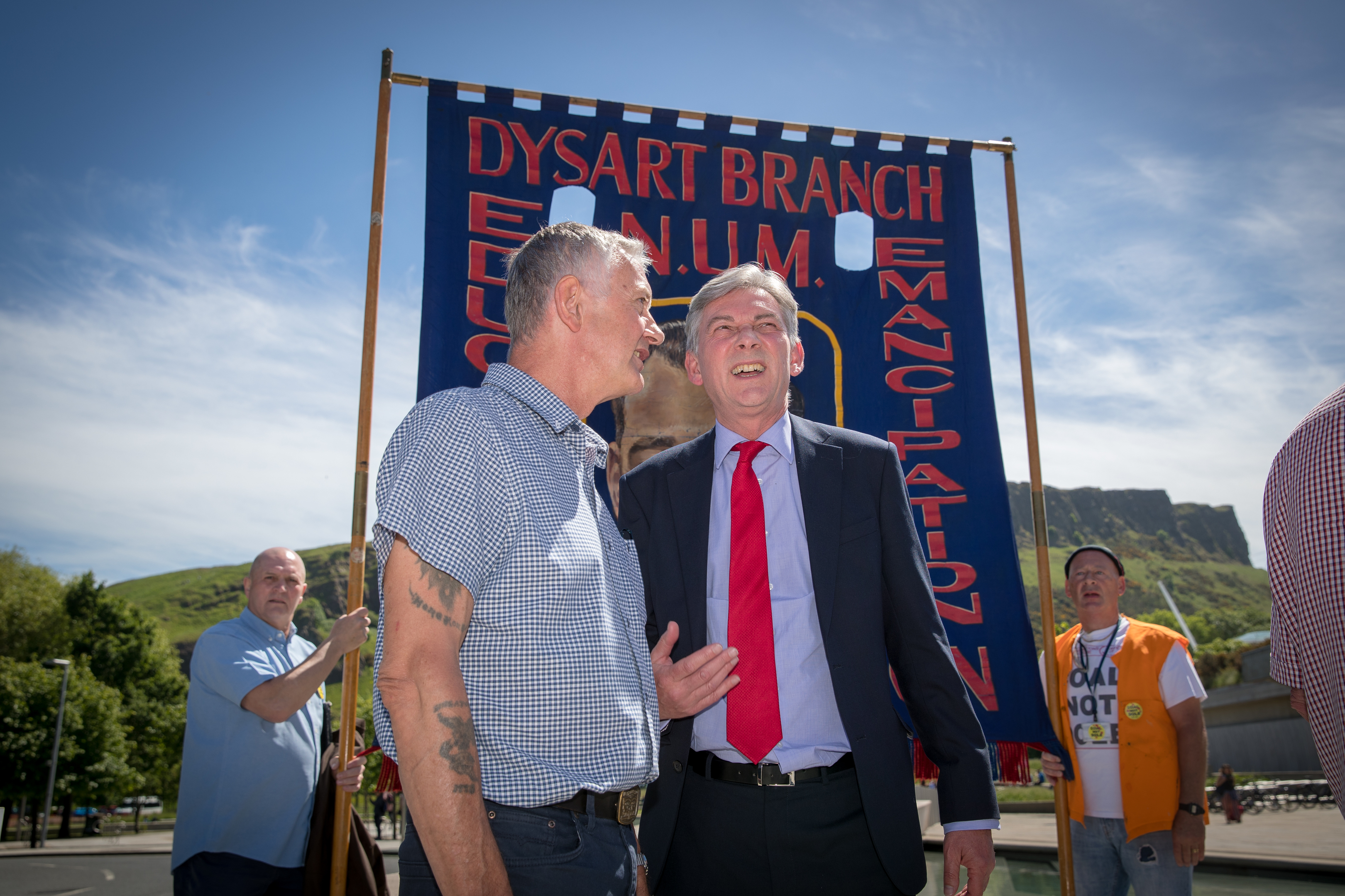 Two ex-miners from Fife, Tom Adams (L) and Bob Young, were met by Scottish Labour leader Richard Leonard along with dozens of former miners who gathered outside  Holyrood before a statement by Justice Minister Michael Matheson.