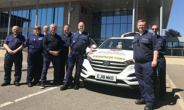 MP Pete Wishart with members of the Perth First Responders charity, taking delivery of the new Hyundai Tucson.