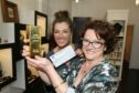 Lorraine Law presented  Marie Curie patron Petra McMilllan with a gold ingot worth £7,603.31, proceeds from the jewellery donated to be melted down.