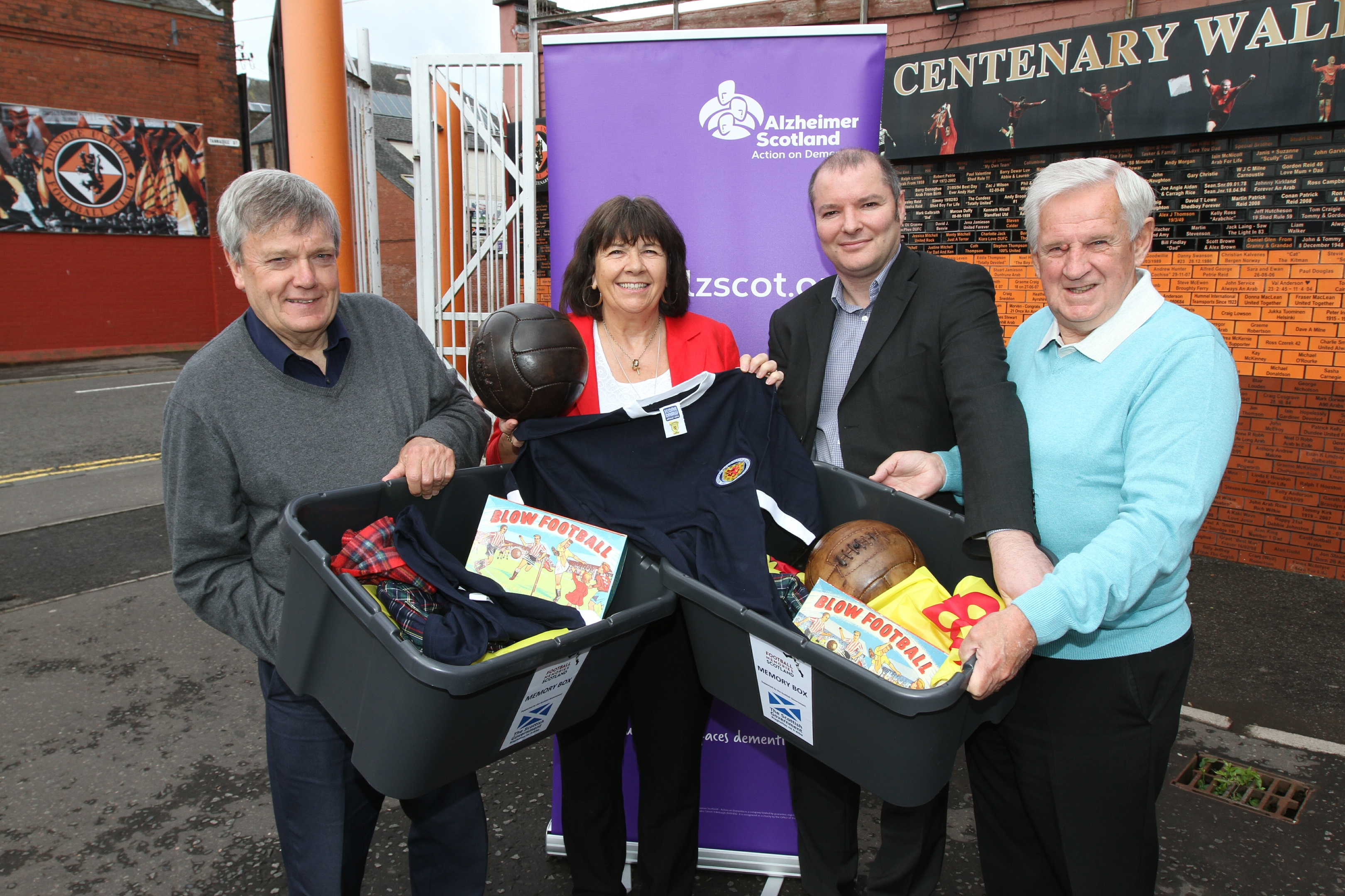 Amanda Kopel and Gordon Wallace receive the memory boxes alongside volunteer Michael Whyte and Richard McBrearty.