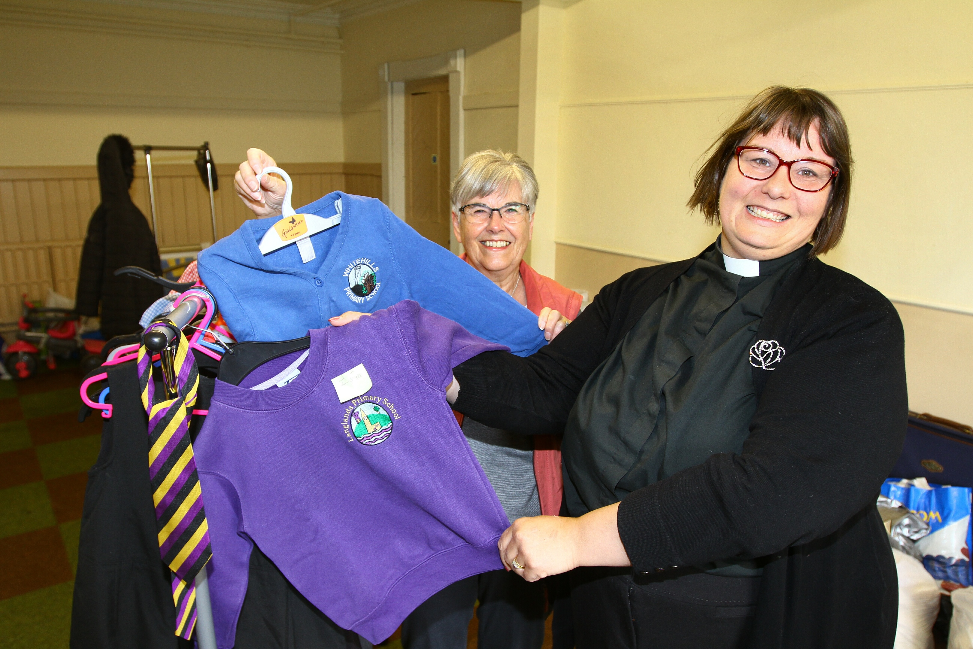 Rev Maggie Hunt & volunteer Helen McLeod are pictured with some of the clothes
