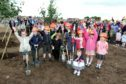 Work begins on Tayport's new Community Hub. Pictured: Derrick Brown & Stephen Lynas from Hadden Construction with Sophie Rennie, Marcus Hegarty, Kai Bates, Maxim Al - Horoub, Meghan McDermott, Lucy Moran, Ivy Lennox, Beth McCallum & Evie Farmer from Tayport Primary school, & in front Aria Abigail Anderson.