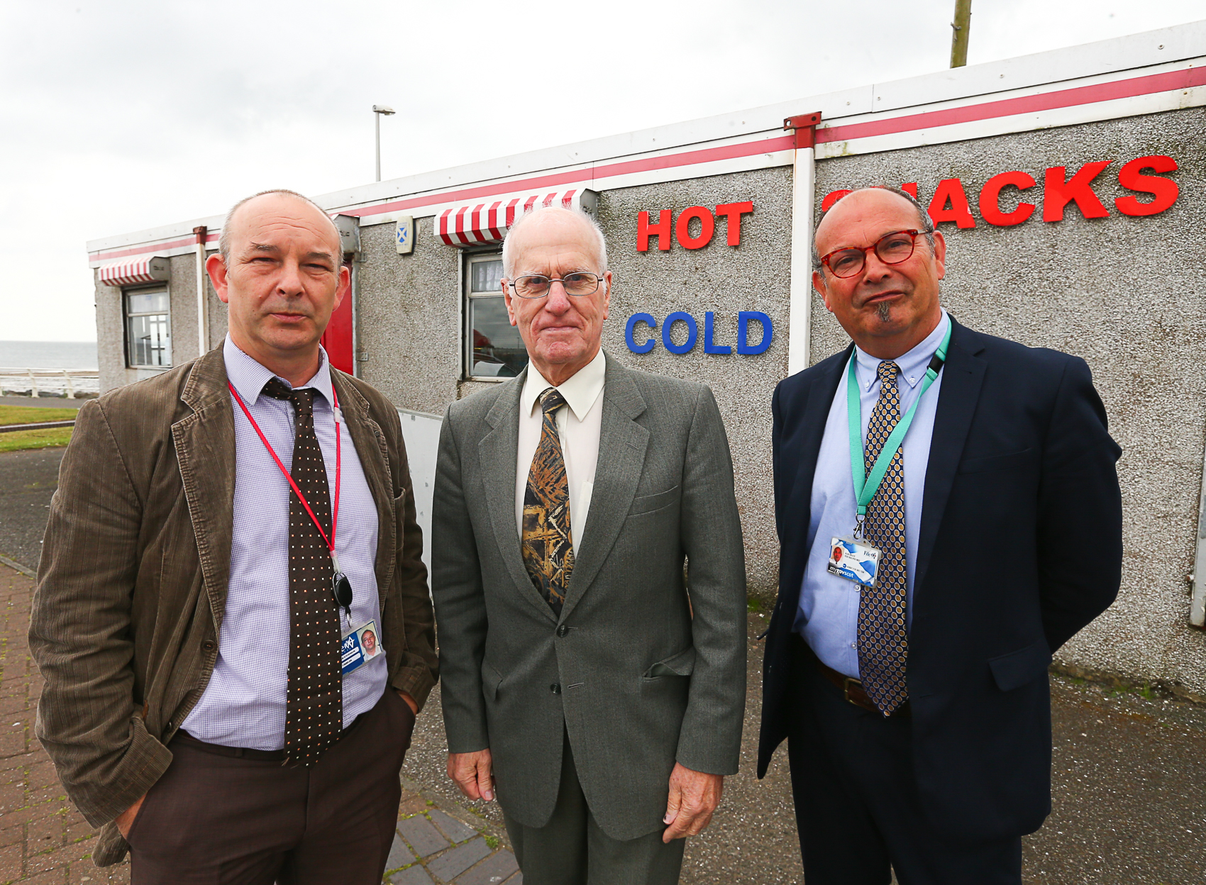Councillor Ross Vettraino in between enforcement officers Billy Stevenson and Alan Bruce