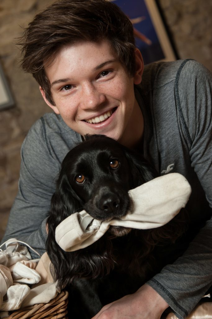 Harris Bell, 18, with the family dog, Izzy,