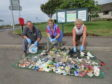 Members of Angus Clean Environments following a recent roadside litter clean-up.