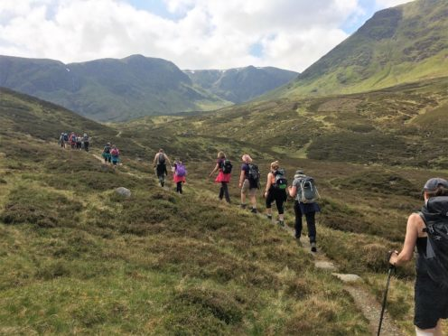 Walkers enjoying the tranquil Angus Glens.