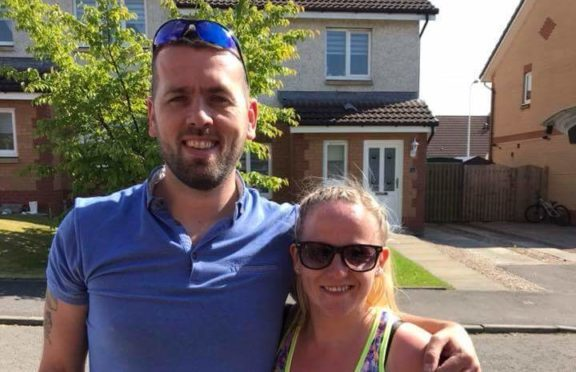Siobhan with her husband Jamie, before setting off for her walk.