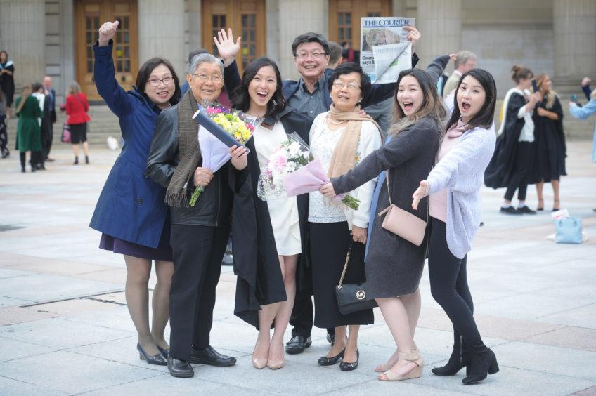 Graduate (centre left) Stephanie Loke and her family celebrate her dentistry graduation.