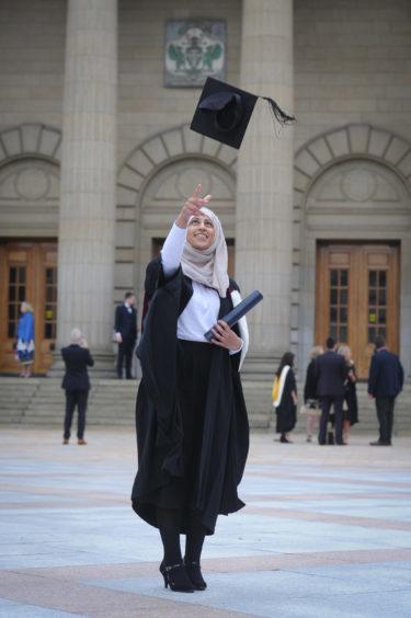 Aleena Ali celebrates after graduating in dentistry.