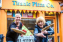 The upcoming Carnoostival festival will feature a pizza flinging competition instead of a discus contest. The pizza bases are being supplied by Marie Fagan (left) of the town's Titanic Pizza. Marie is shown with festival organiser Suzi Caesar.