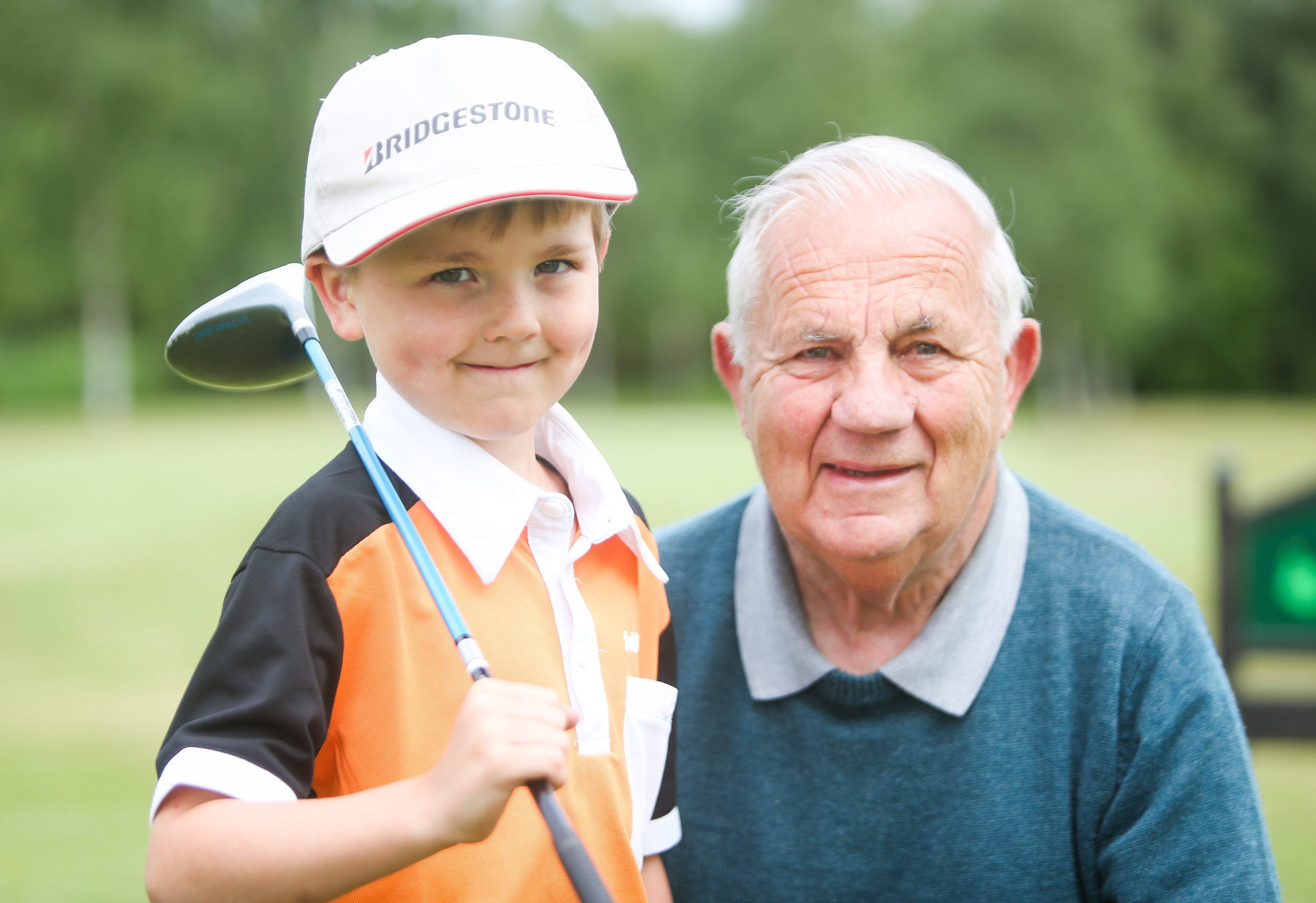 Archie Pattullo with grandad, Don Murray on Strathmore Golf Club.