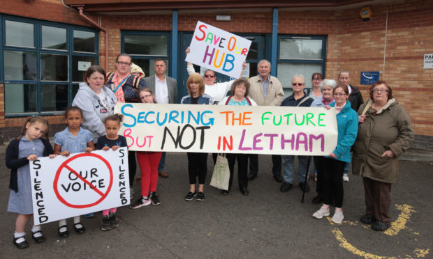 Letham locals protest outside Letham recreation Centre.