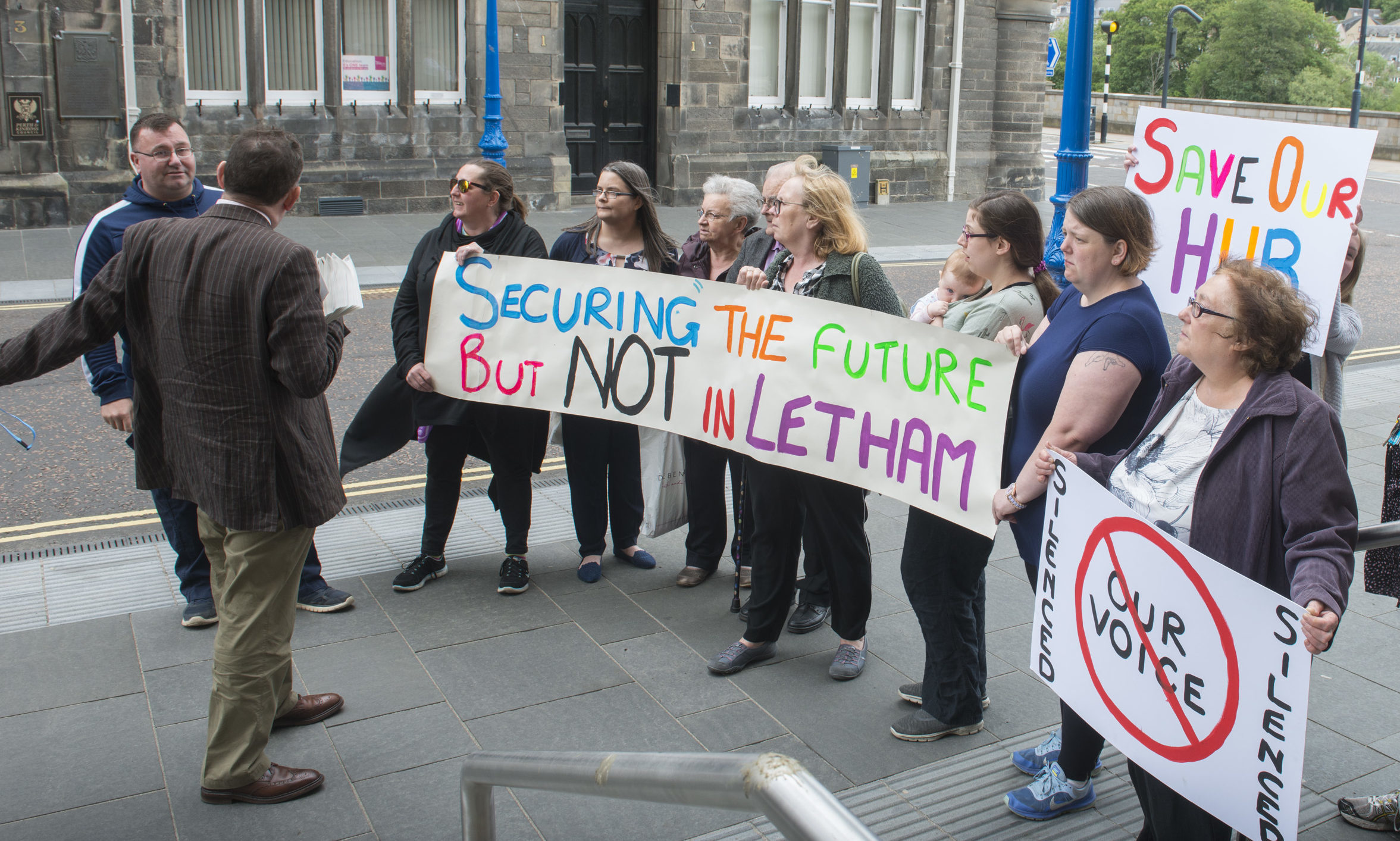 Protesters demonstrate outside Perth and Kinross Council HQ.