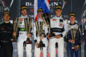 Sandy Mitchell (centre) on top of the Paul Ricard podium with teammates Michele Beretta and Martin Kodric