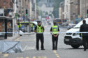 Police at the scene of the violent assault in South Street, Perth, in June last year.