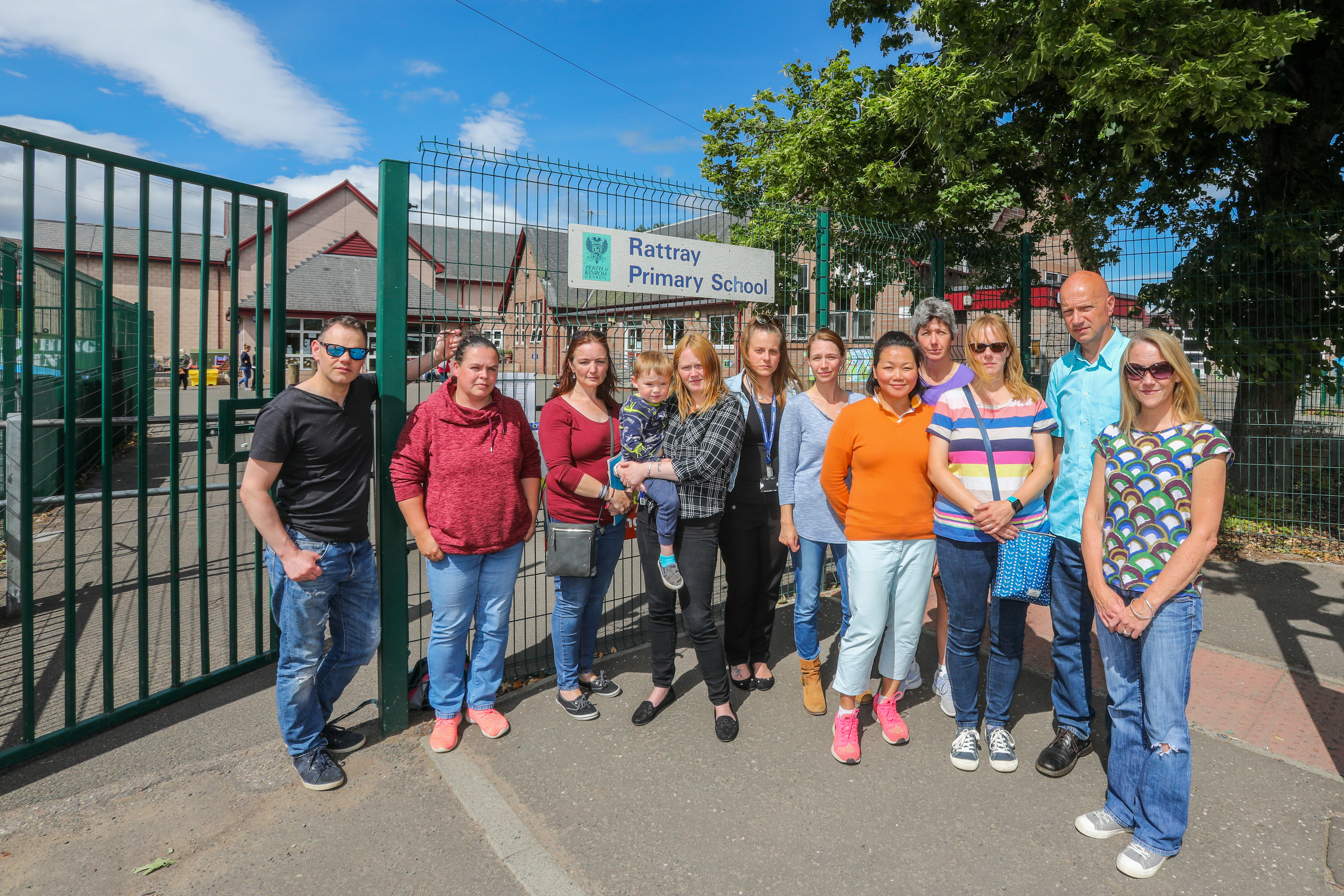 Parents outside school grounds with nursery entrance in background. Rattray Primary School, High Street, Rattray.