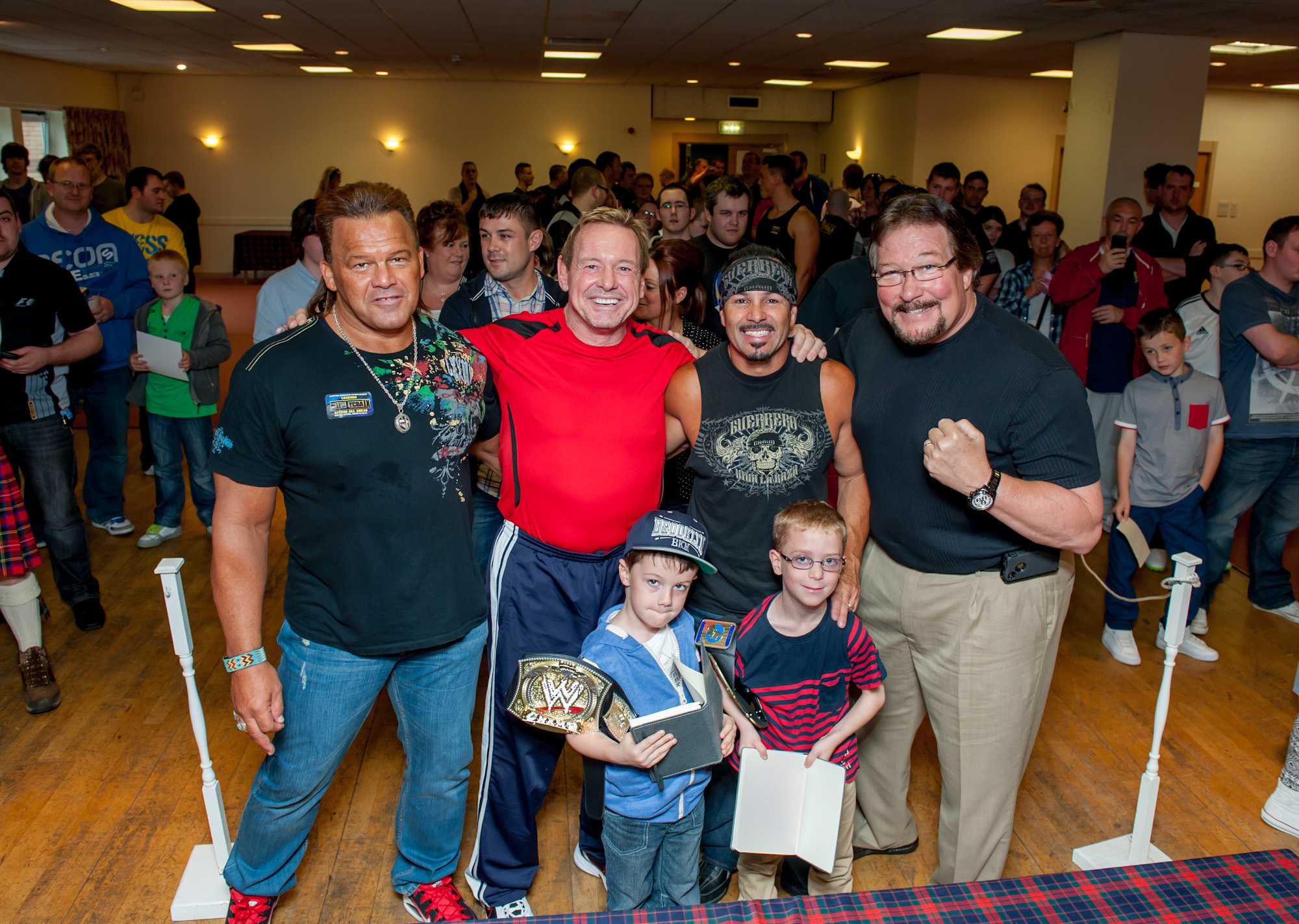 Former WWE superstars in Dundee for a previous Hell for Lycra event. From left, Tatanka, Rowdy Roddy Piper, Chavo Guerrero and Ted DiBiase with young fans
