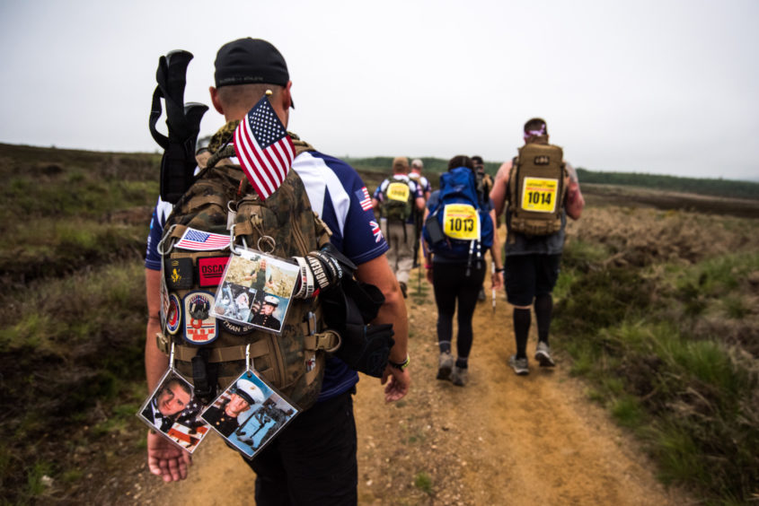 The walkers represented more than ten different countries including the United Kingdom, USA, Denmark, Ukraine, Estonia and Georgia, faced mixed weather conditions from sunshine to rainstorms on the 54 mile route around the foothills of the Cairngorms.