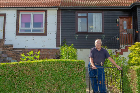 Mr Mitchell at his Milne Crescent home
