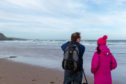 Landscape photographer Gavin Ritchie gives Gayle Ritchie a one-to-one lesson at Lunan Bay.