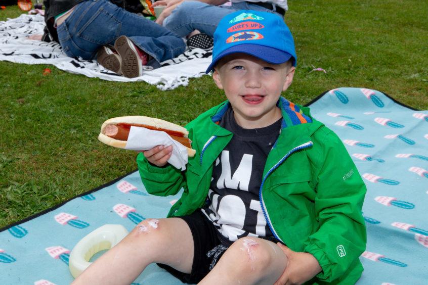 George Brown (3) enjoys his Hot Dog at Markinch Highland Games