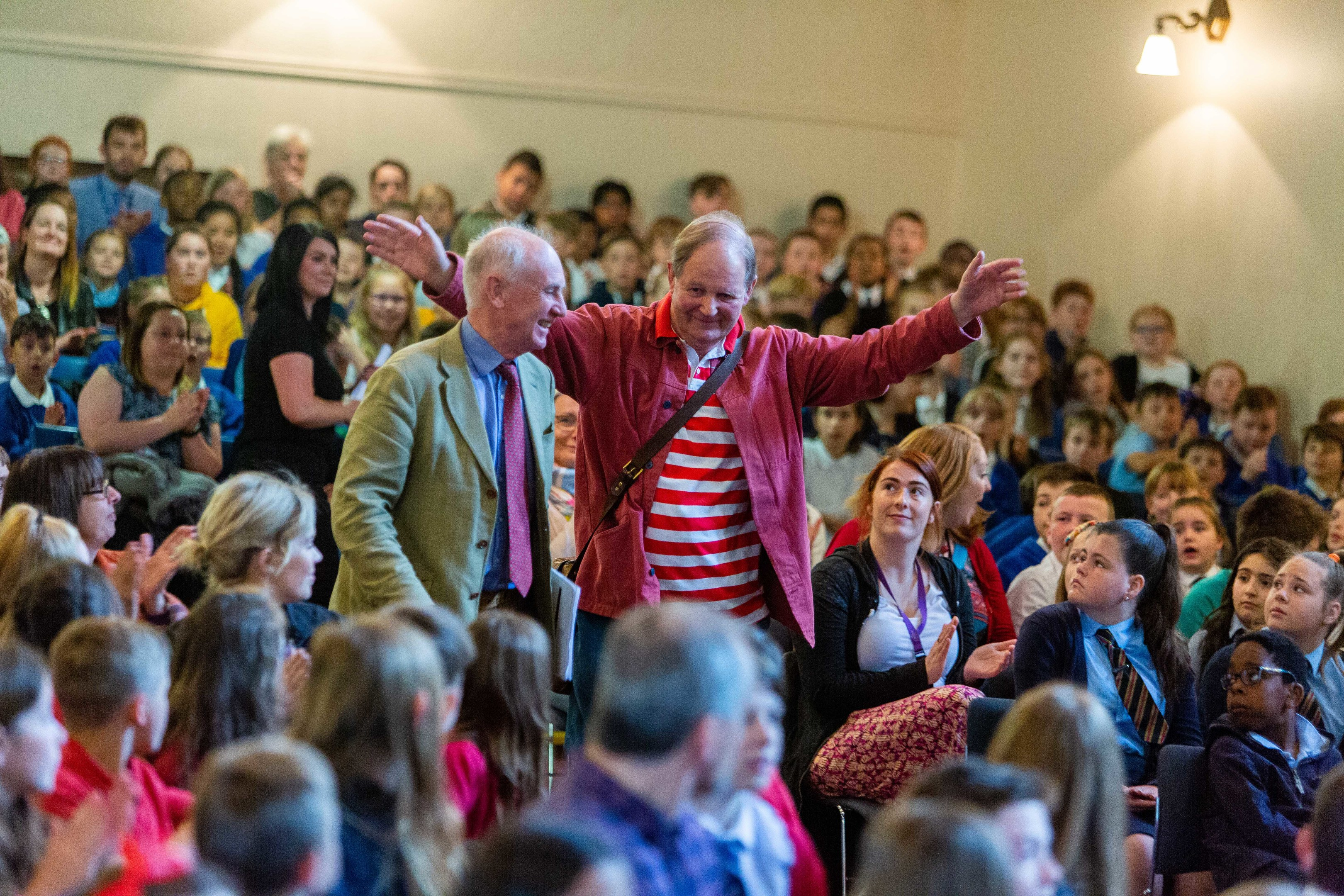 Sir Michael Morpurgo (right) arrives with Sir Hew Strachan at the Younger Hall.