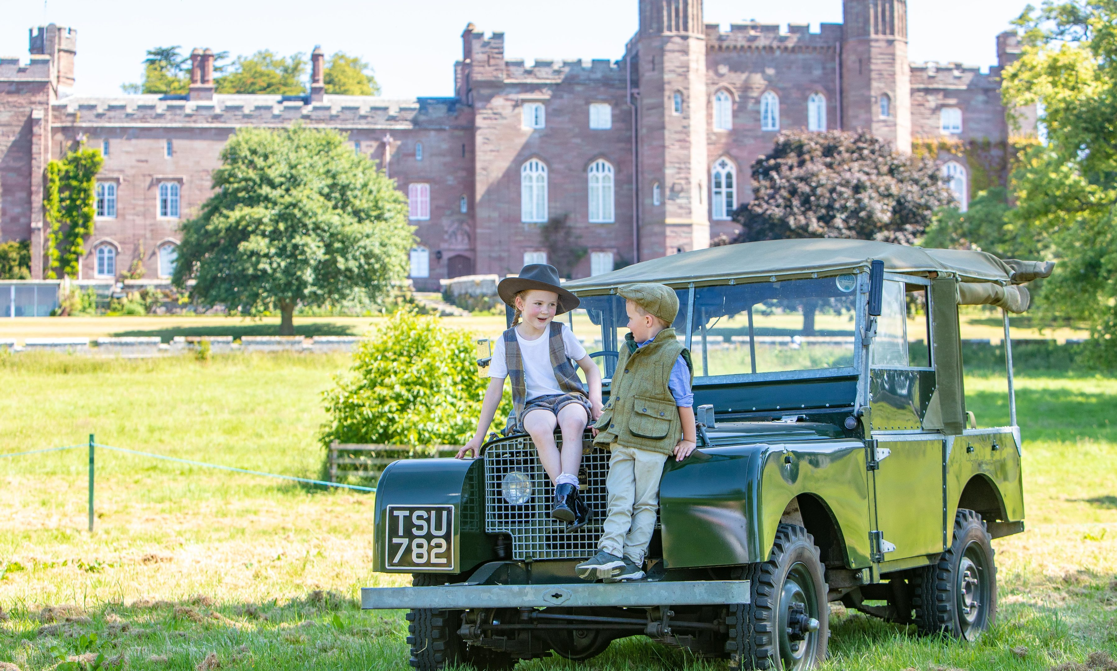 Isabella McGregor (5) and Cody Kerr (5) on a vintage Land Rover, in the grounds of Scone Palace.