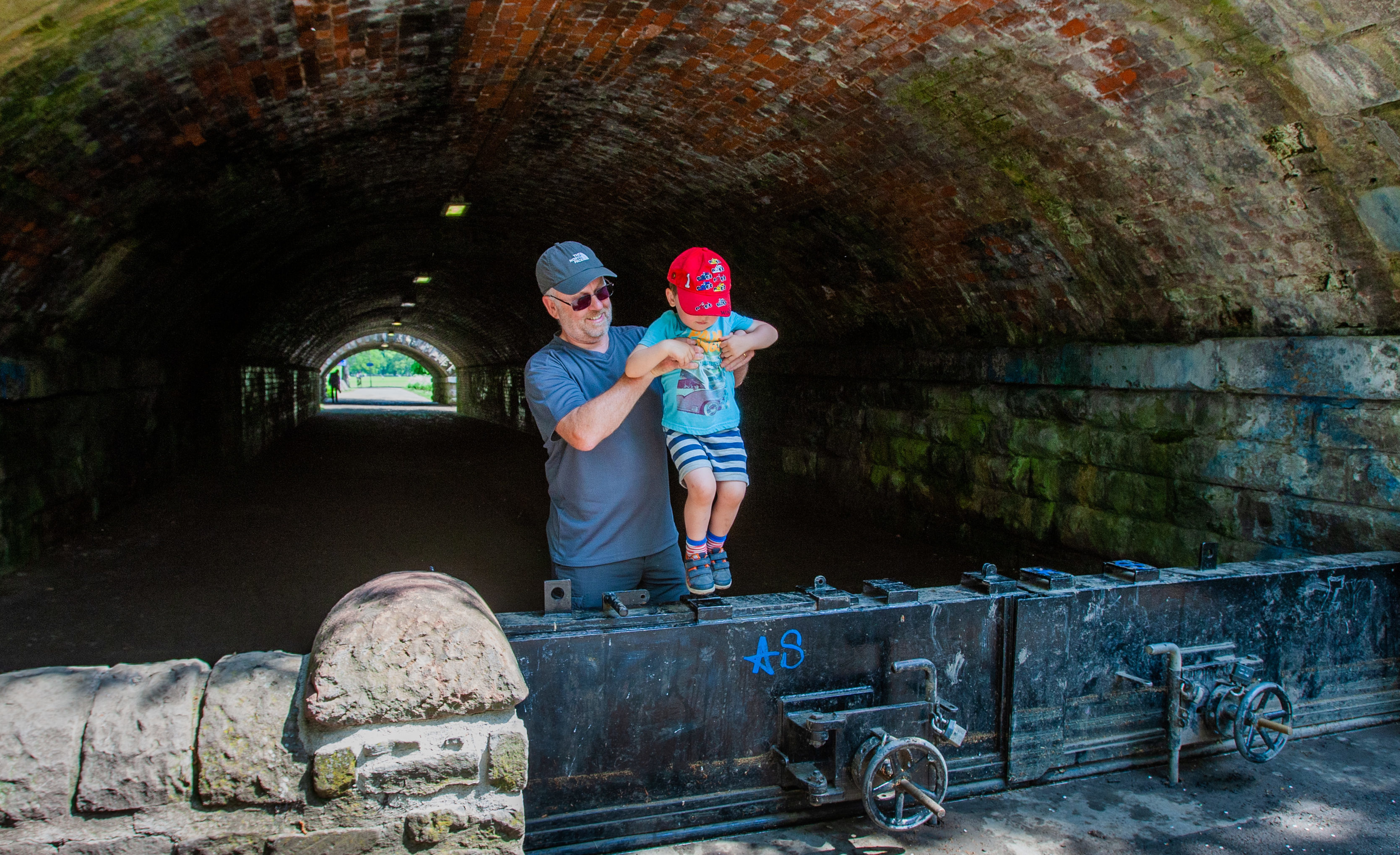 Llocal resident Willie White and grandson Adam White (aged 3 ) trying to get across the flood defence barrier. at the South Inch underpass.