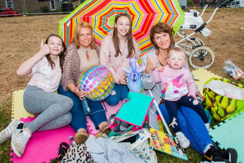 Casey Craig (aged 12), Mel McCormack, Kora Craig (aged 12, Casey's twin sister), Debbie Clark and baby Ella Rose Millen (aged 2) all from Coldside, Dundee.