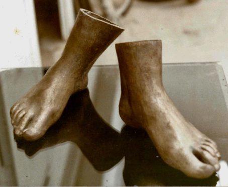 Judith's bronze feet.