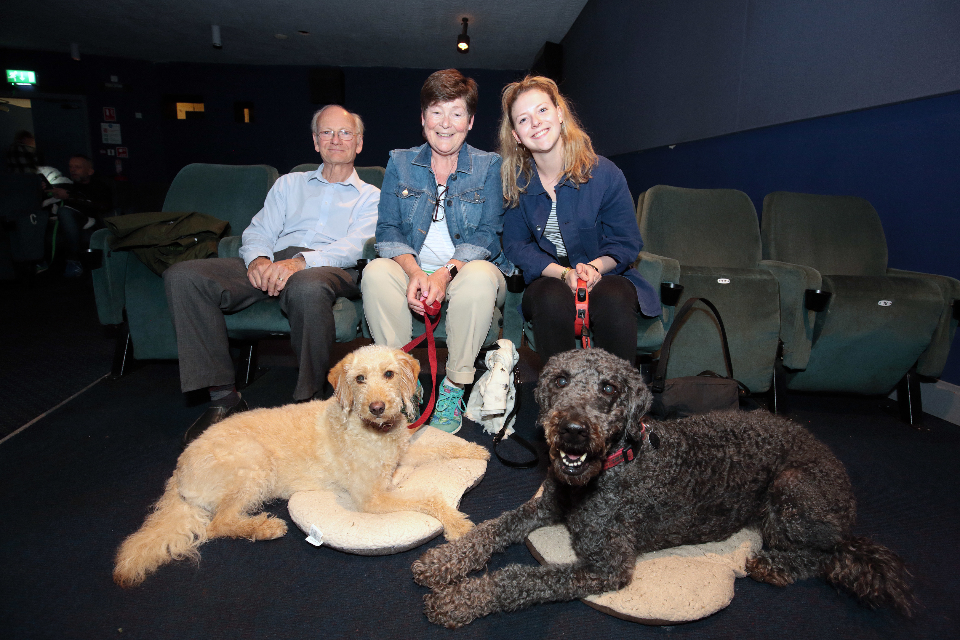 Waiting for the film to start are Keith, Debbie and Christina Gordon with Bonnie (left) and Cormac.