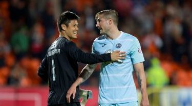Frederic Frans (right) with then United goalkeeper Eiji Kawashima
