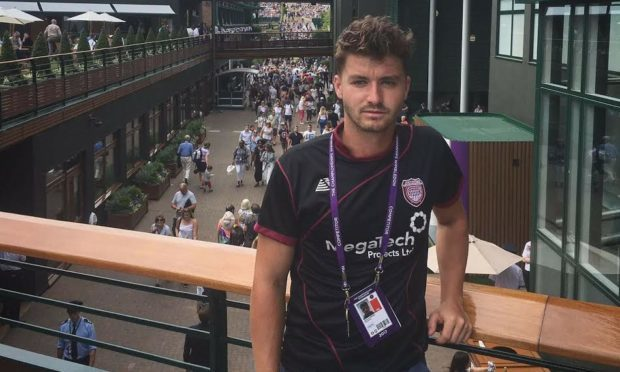 Jonny O' Mara sporting a Lichties top at Wimbledon.