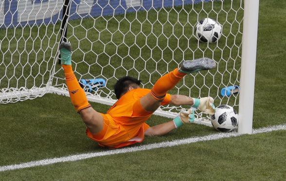Eiji Kawashima lets a free-kick in at his near post.