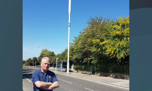 Councillor Craig Duncan with the mast on Strathern Road