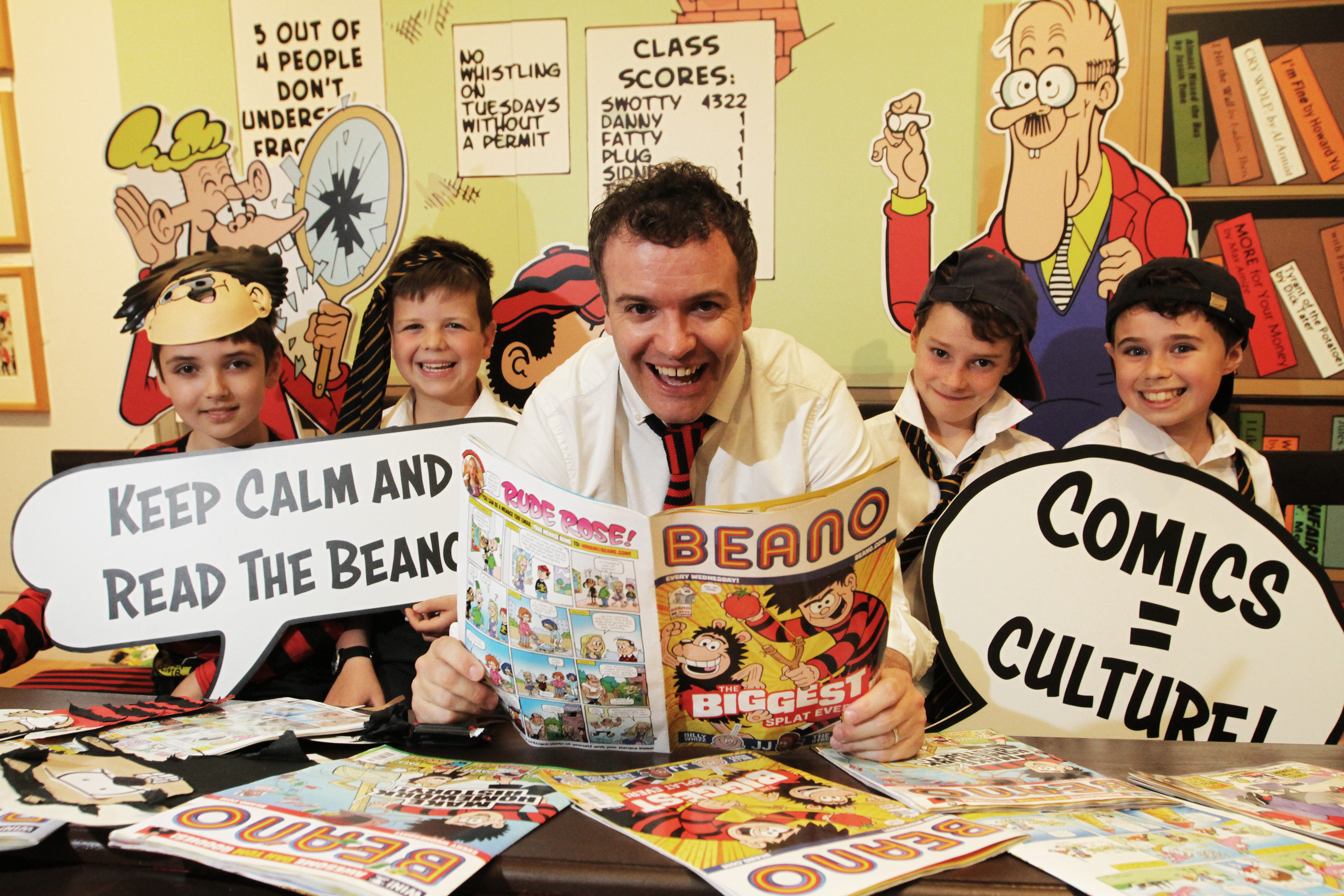 A new exhibition of all things Beano has opened with a class from Dundee High School attending.  Picture shows; l to r, Sam Brass, 9, Finlay Thomas, 9, Head of Beano Studios Scotland, Mike Stirling, Matthew Milne, 10 and Sam Blackhall, 10