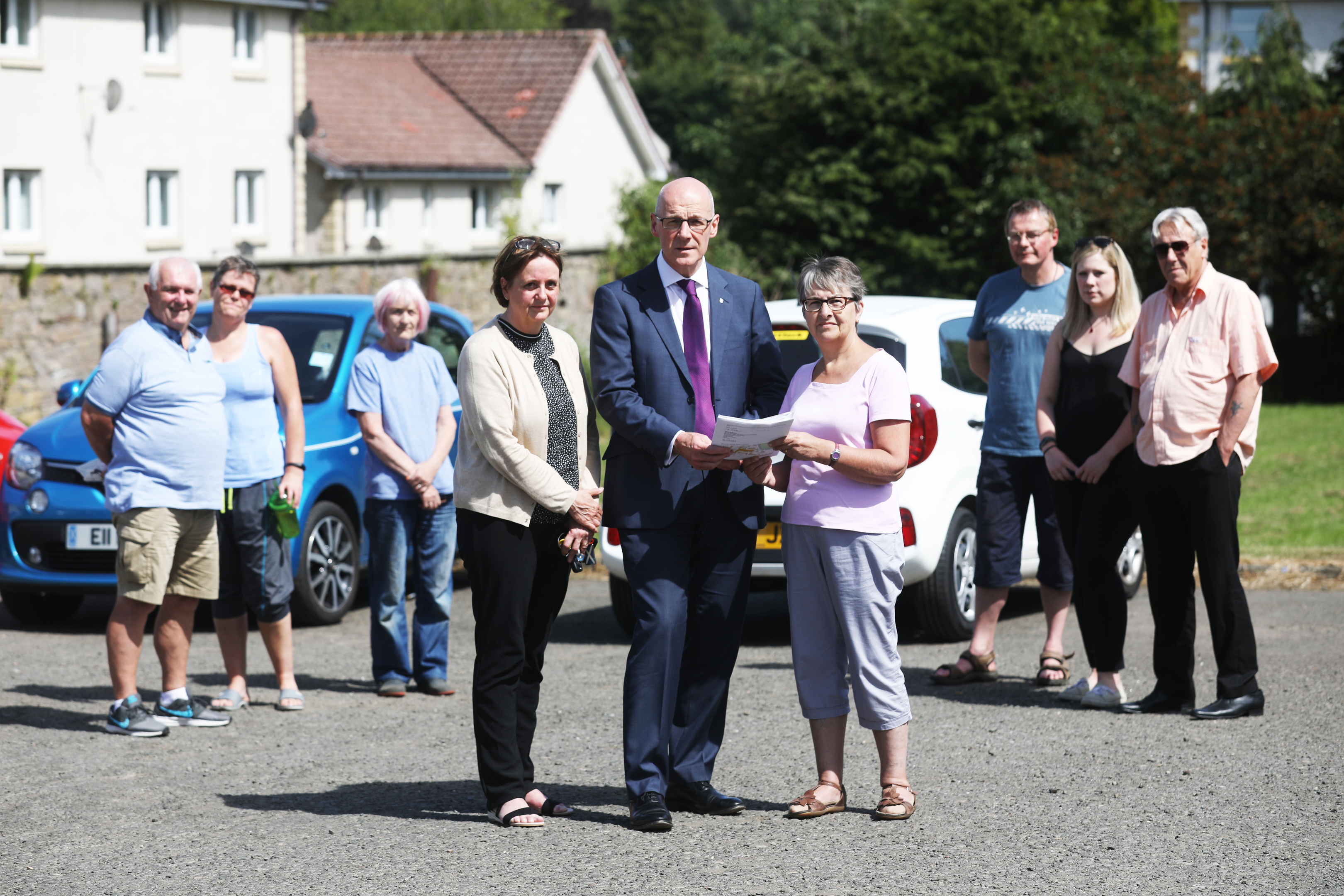 Councillor Beth Pover (left), Perthshire North MSP John Swinney and resident Hilda Edmonds  with more concerned villagers.