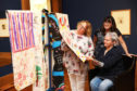 Helen Smout (left) chief executive of Culture Perth and Kinross admires the artwork with Judith Stewart from Corton Vale prison and artist Jill Skulina.
