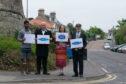 Aashish Ahujia (Playfair Team Leader), Dita Stanis-Traken (StARLink Secretary), Jane Ann Liston (StARLink Convenor), and Richard Batchelor (StARLink Treasurer) in front of the old station site in St Andrews.