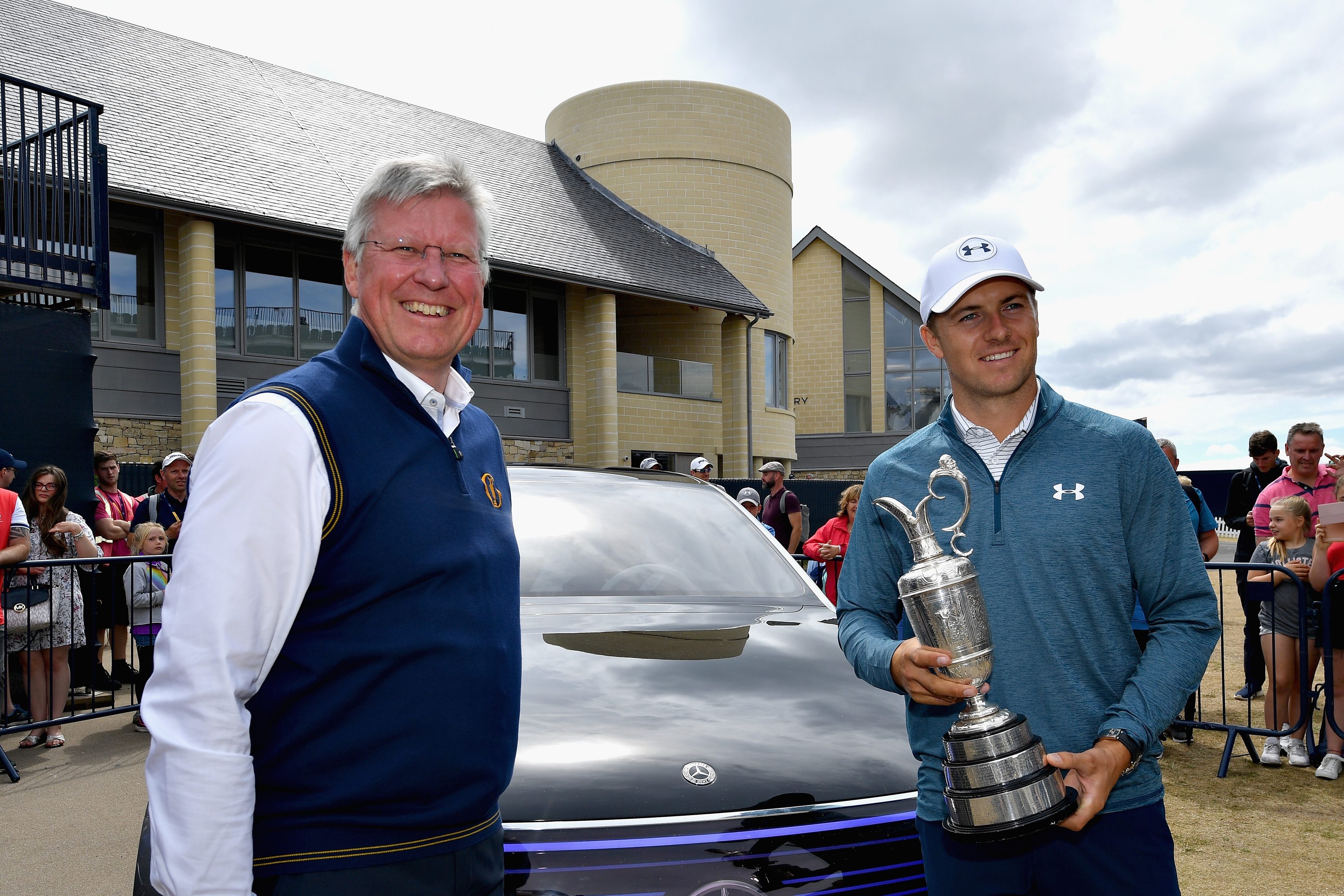 Jordan Spieth rpepares to relinquish the Caret Jug back into the care of Martin Slumbers at Carnoustie yesterday.