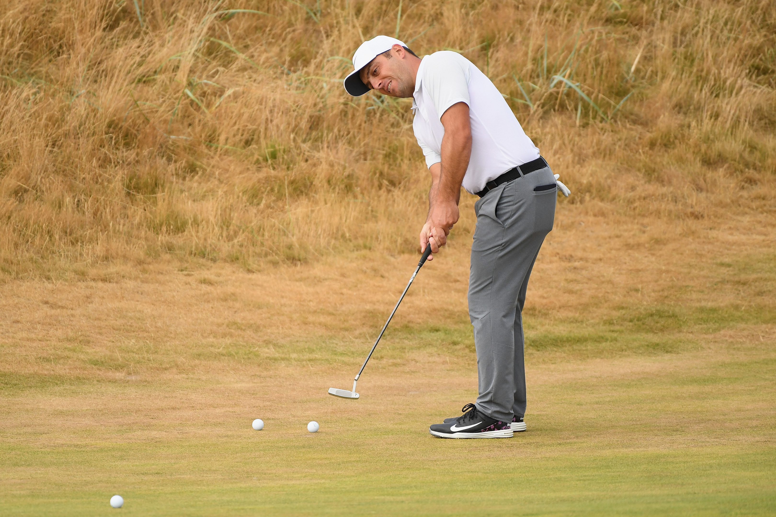 Francesco Molinari of Italy putts on the first hole during previews to the 147th Open Championship at Carnoustie Golf Club.