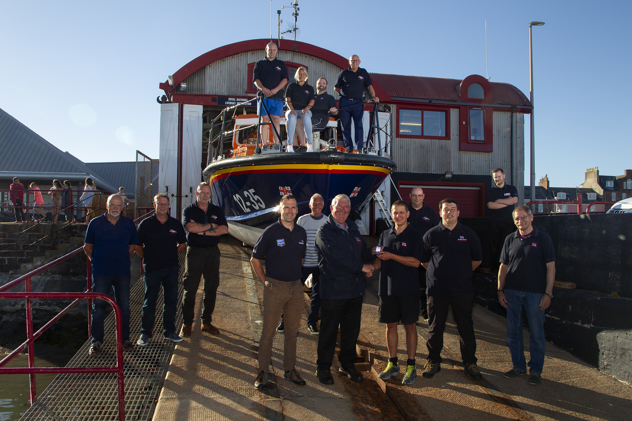 Arbroath RNLI crew with (front left to right): Area lifesaving manager Gavin Baird, operations manager Alex Smith, Peter Willis, Sam Clow and Ron Churchill.
