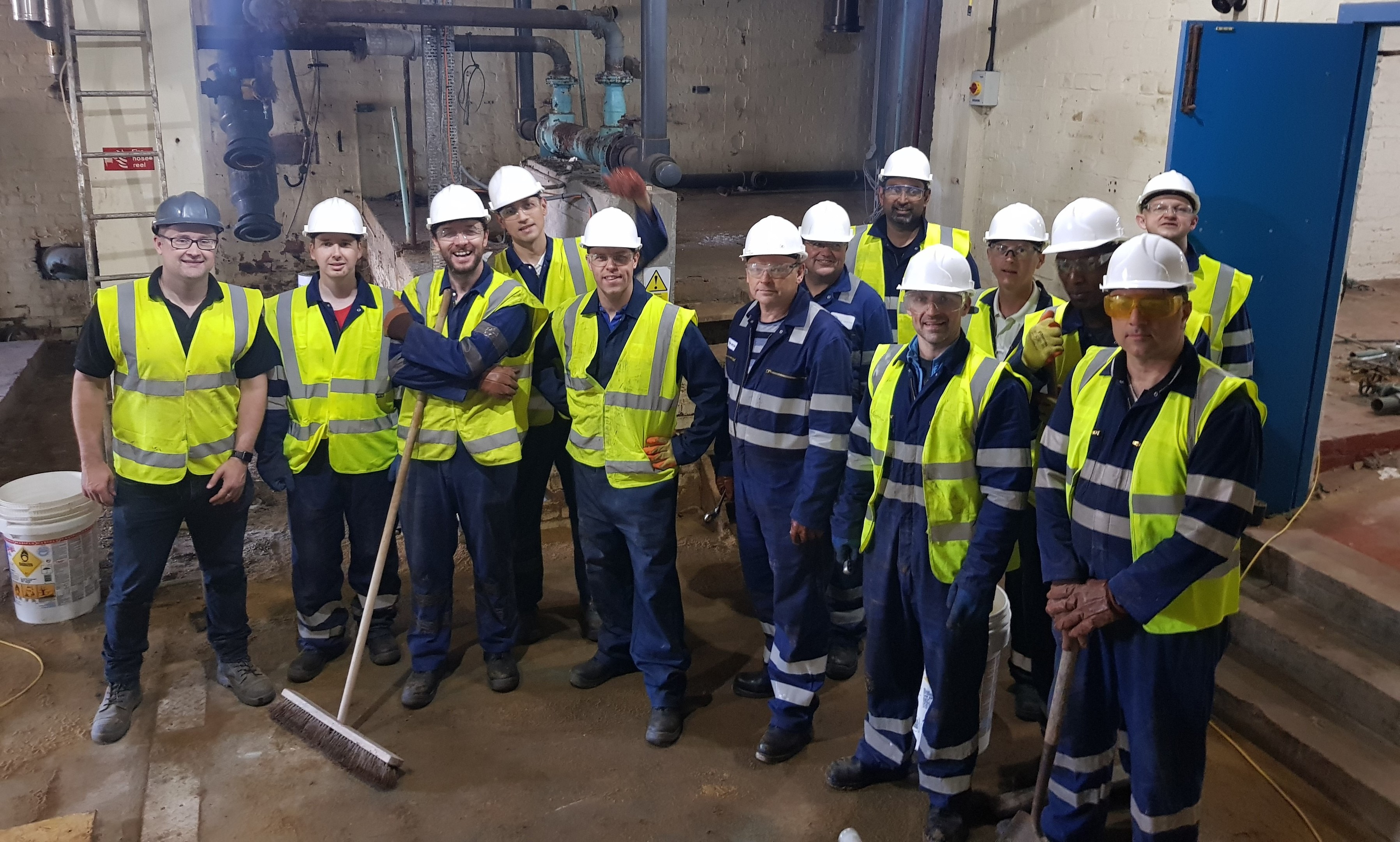 David Paton, left, with the Baker Hughes team.