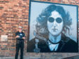 Artist Ian Cuthbert Imrie with his new painting Imagine, in Perth city centre.