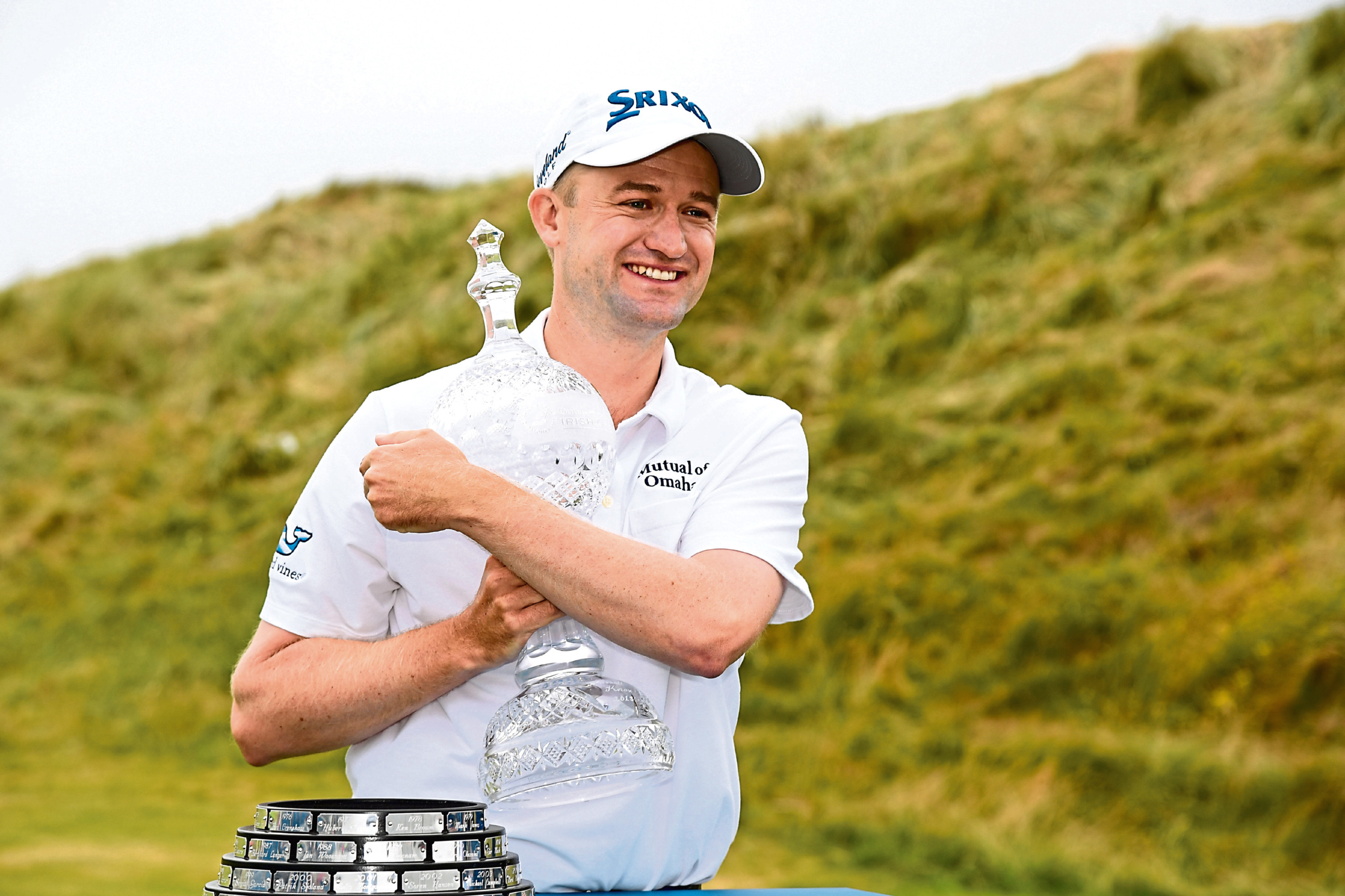 DONEGAL, IRELAND - JULY 08:    Russell Knox of Scotland poses with the trophy following his victory on the 18th green during a playoff at the end of the final round of the Dubai Duty Free Irish Open at Ballyliffin Golf Club on July 8, 2018 in  Donegal, Ireland. (Photo by Ross Kinnaird/Getty Images)