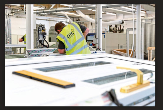 A worker at CMS Window Systems' factory in Kirkcaldy.